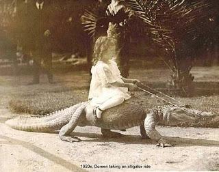 girl riding alligator.jpg